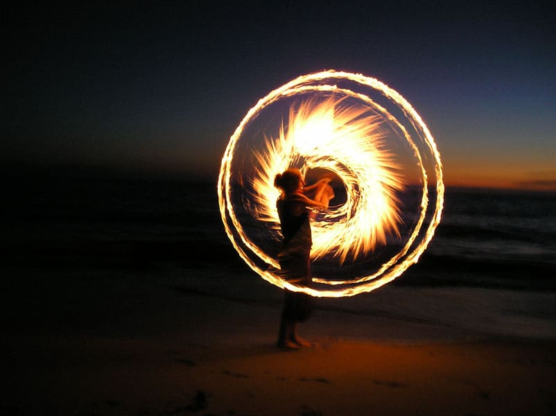 fire spinning at night